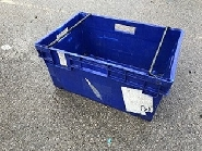 industrial crate with swing arm for stacking